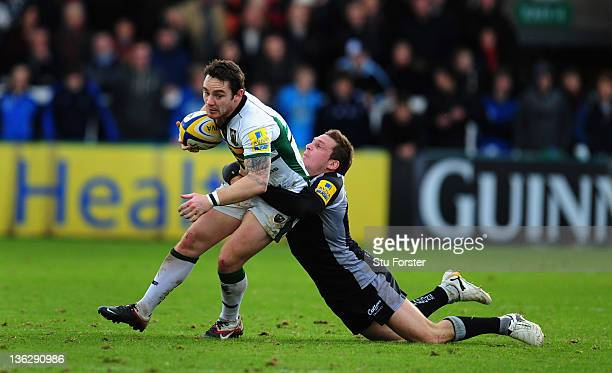 Saints flyhalf Ryan Lamb is tackled by Jimmy Gopperth of the Falcons during the Aviva Premiership match between Newcastle Falcons and Northampton...