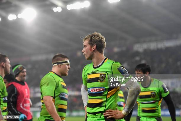 Saints fullback Harry Mallinder and team mates react after the Ospreys score their fourth try during the European Rugby Champions Cup match between...
