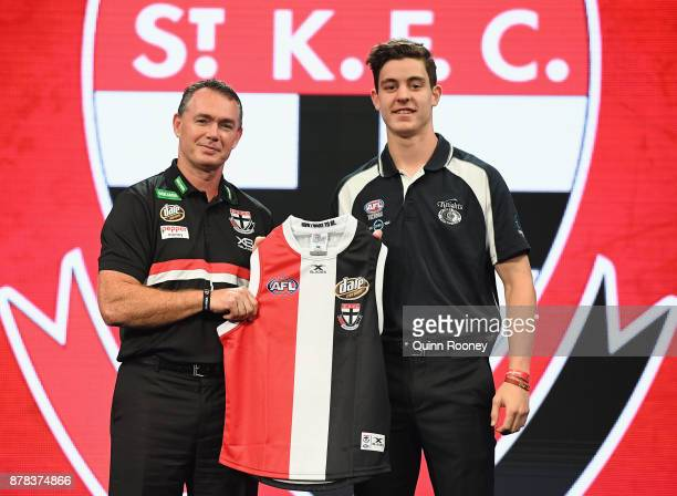 Saints head coach Alan Richardson poses with Nicholas Coffield during the 2017 AFL Draft at Sydney Showgrounds on November 24 2017 in Sydney Australia