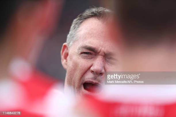 Saints head coach Alan Richardson talks to players during the round seven AFL match between the Greater Western Sydney Giants and the St Kilda Saints...