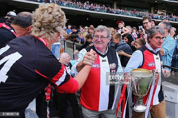 Saints legends Robert Neale and Barry Breen bring out the 1966 Premiership Cup during the round three AFL match between the St Kilda Saints and the...