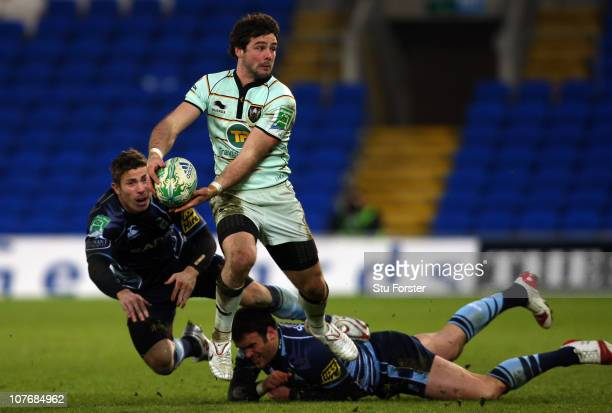 Saints player Ben Foden rides the tackle of Blues player Jamie Roberts during the Heineken Cup Pool One match between Cardiff Blues and Northampton...