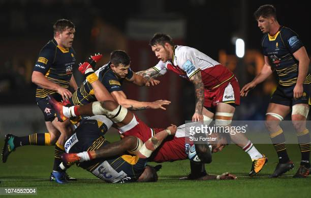 Saints player Courtney Lawes runs through a tackle by Warriors number 3 Nick Schonert during the Gallagher Premiership Rugby match between Worcester...