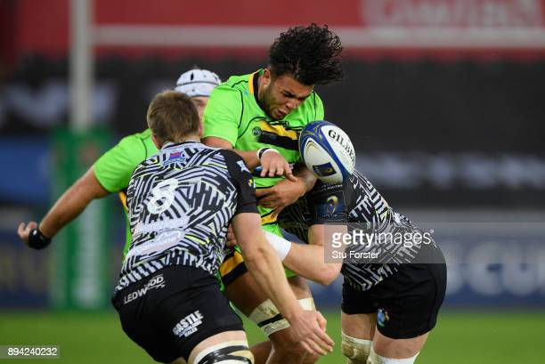 Saints player Lewis Ludlam is smashed into by the Ospreys defence during the European Rugby Champions Cup match between Ospreys and Northampton...