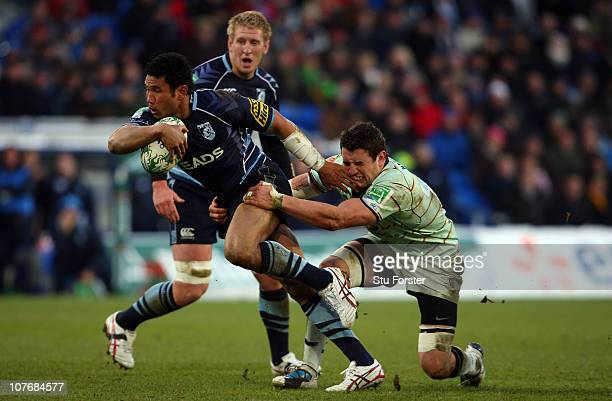 Saints player Roger Wilson attempts to tackle Blues centre Casey Laulala during the Heineken Cup Pool One match between Cardiff Blues and Northampton...