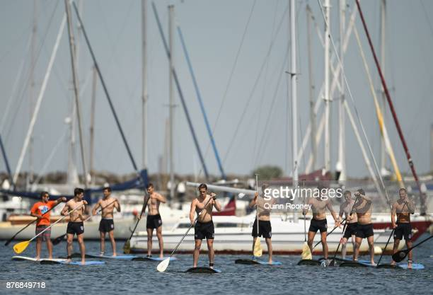 Saints players do stand up paddleboarding during a St Kilda Saints AFL training session at Catani Gardens on November 21 2017 in Melbourne Australia