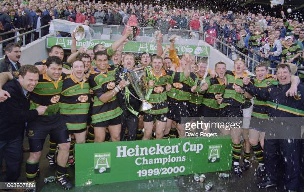 Saints players Pat Lam and Ben Cohen hold the trophy as the team celebrate their 9-8 Heineken Cup Final victory over Munster on May 27, 2000 at...