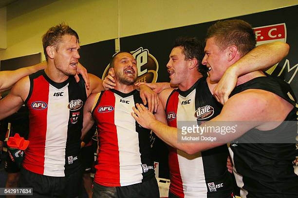 Saints players sing the club song after winning during the round 14 AFL match between the St Kilda Saints and the Geelong Cats at Etihad Stadium on...