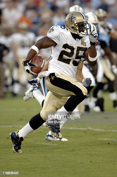 Saints Reggie Bush runs with the ball during first half action between The Tennessee Titans and the New Orleans Saints at The Coliseum in Nashville,...