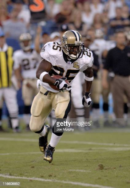 Saints Reggie Bush runs with the ball during first half action between The Tennessee Titans and the New Orleans Saints at The Coliseum in Nashville...