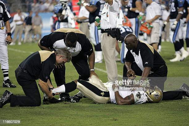 Saints running back Aaron Stecker is tended to by trainers after suffering an injury during action between the New Orleans Saints and the Tennessee...