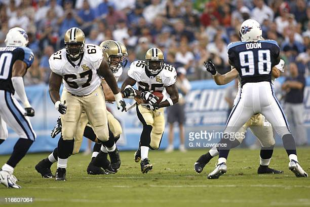 Saints running back Reggie Bush looks for an opening during action between the New Orleans Saints and the Tennessee Titans at LP Field in Nashville,...
