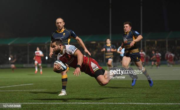 Saints scrum half Cobus Reinach dives over the line to score the first try during the Gallagher Premiership Rugby match between Worcester Warriors...