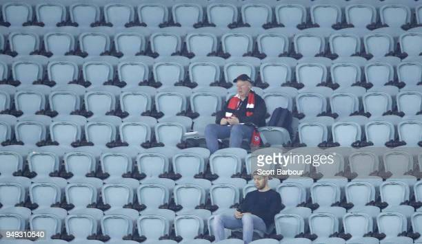Saints supporters in the crowd watch the match during the round five AFL match between the St Kilda Saints and the Greater Western Sydney Giants at...