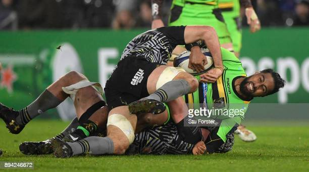 Saints wing Ahsee Tuala is stopped by the Ospreys defence during the European Rugby Champions Cup match between Ospreys and Northampton Saints at...