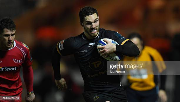 Saints wing George North breaks through to score the fourth Saints try and gain a bonus point during the European Rugby Champions Cup match between...