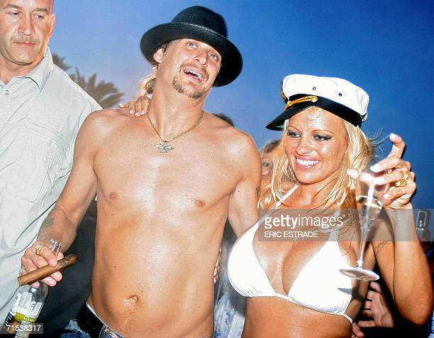Canadian actress Pamela Anderson shares a drink with her husband US musician Kid Rock the day of their wedding on Pampelone's beach in SaintTropez...