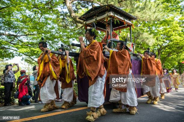Participants in Heian period dress parade through the grounds of Kyoto Imperial Palace during the Aoi Festival on May 15 2018 in Kyoto Japan Aoi...