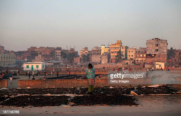 Saira Banu sorts burnt scraps of leather that will be processed as fish and chicken feed November 10 2013 in the Hazaribagh neighborhood of Dhaka...