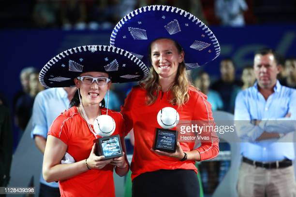Saisai Zheng of China and Victoria Azarenka of Belarus celebrate with the trophy of Women's Doubles final as part of the day 6 of the Telcel Mexican...