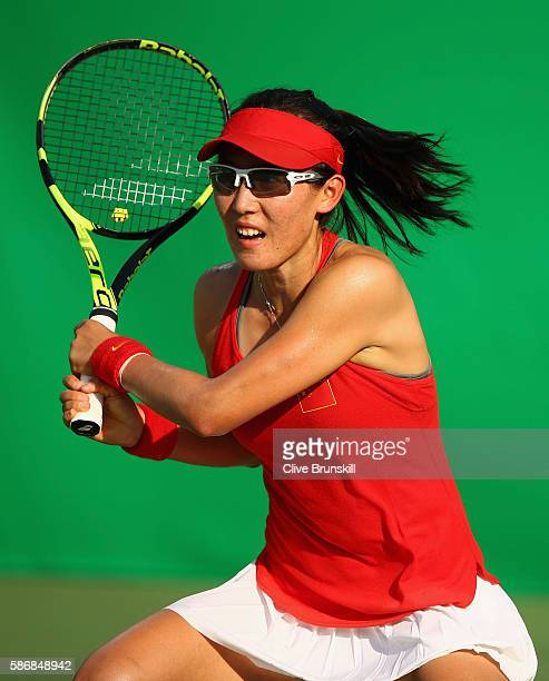 Saisai Zheng of China in action against Agnieszka Radwanska of Poland in their first round match on Day 1 of the Rio 2016 Olympic Games at the...