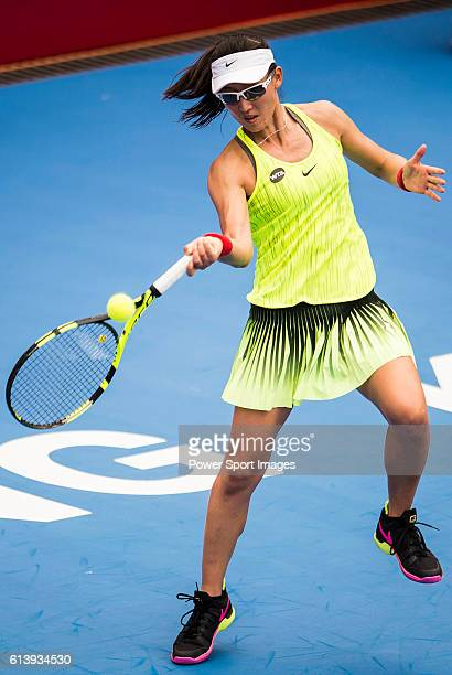 Saisai Zheng of China in action against Caroline Wozniacki of Denmark during the 2016 Hong Kong Open at Victoria Park on October 11 2016 in Hong Kong...