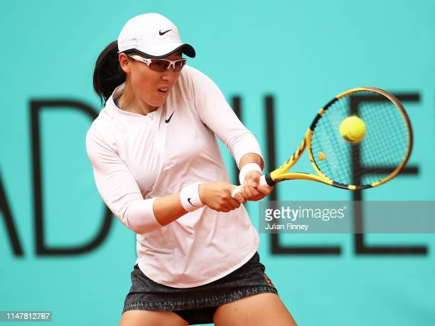 Saisai Zheng of China in action against Sloane Stephens of USA during day five of the Mutua Madrid Open at La Caja Magica on May 08 2019 in Madrid...