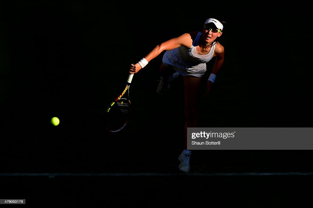 Saisai Zheng of China in action in her Ladies Singles first round match against Caroline Wozniacki of Denmark during day two of the Wimbledon Lawn Tennis Championships at the All England Lawn Tennis and Croquet Club on June 30, 2015 in London, England.