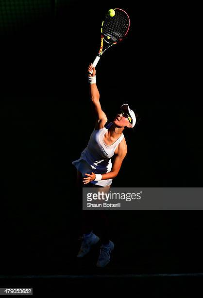 Saisai Zheng of China in action in her Ladies Singles first round match against Caroline Wozniacki of Denmark during day two of the Wimbledon Lawn...