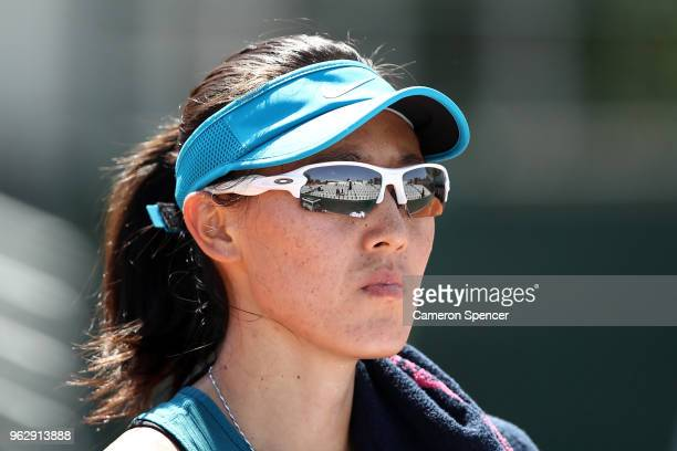 Saisai Zheng of China looks on during her first round women's singles match against Ekaterina Makarova of Russia on day one of the French Open at...