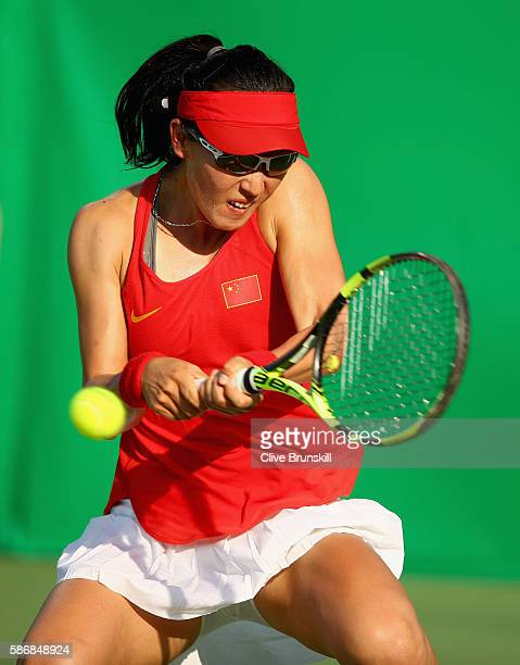 Saisai Zheng of China plays a backhand against Agnieszka Radwanska of Poland in their first round match on Day 1 of the Rio 2016 Olympic Games at the...