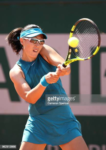 Saisai Zheng of China plays a backhand during her first round women's singles match against Ekaterina Makarova of Russia on day one of the French...