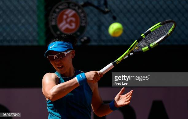 Saisai Zheng of China plays a forehand during her first round women's singles match against Ekaterina Makarova of Russia on day one of the French...