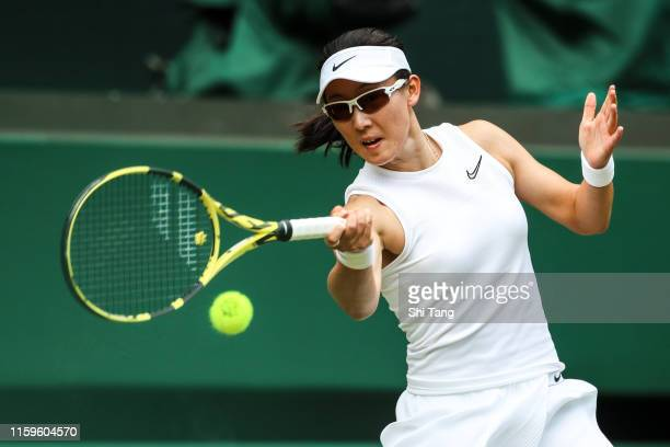 Saisai Zheng of China plays a forehand in her Ladies' Singles first round match against Ashleigh Barty of Australia during Day Two of The...