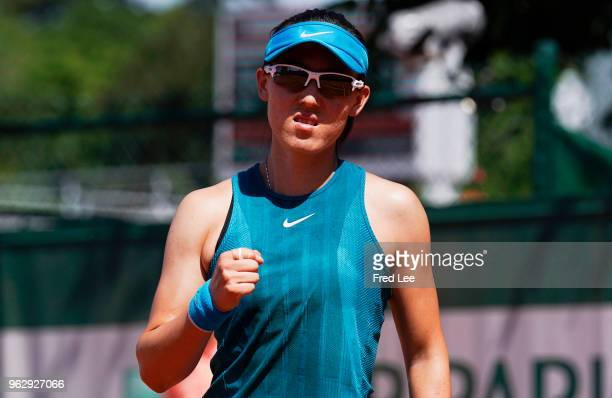 Saisai Zheng of China react during her first round women's singles match against Ekaterina Makarova of Russia on day one of the French Open at Roland...