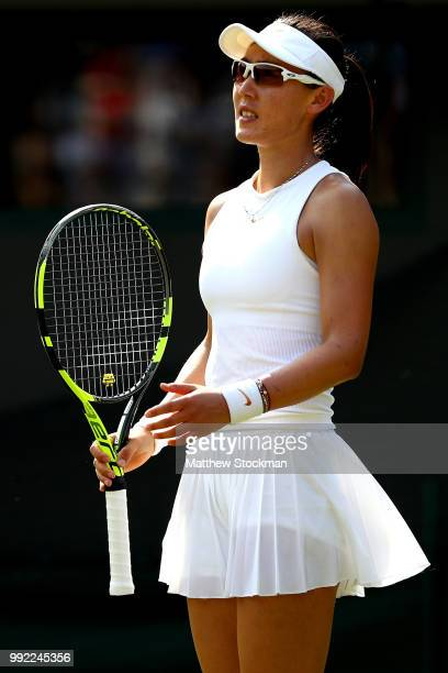Saisai Zheng of China reacts against Simona Halep of Romania in their Ladies' Singles second round match on day four of the Wimbledon Lawn Tennis...