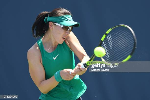 Saisai Zheng of China returns a backhand shot to Allie Kiick of the US during a quarterfinal match on Day Eight of the Citi Open at the Rock Creek...