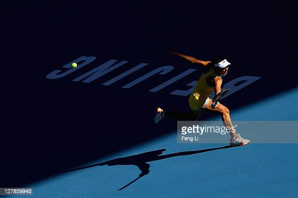 Saisai Zheng of China returns a shot to Kaia Kanepi of Estonia during day two of the China Open at the National Tennis Center on October 2 2011 in...