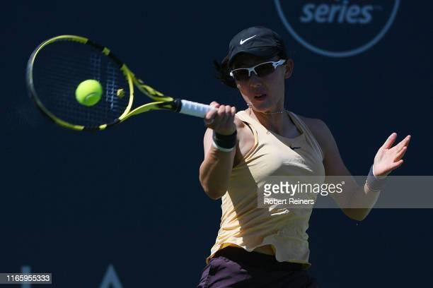 Saisai Zheng of China returns a shot to Maria Sakkari of Greece during their semifinal match in the Mubadala Silicon Valley Classic at the San José...