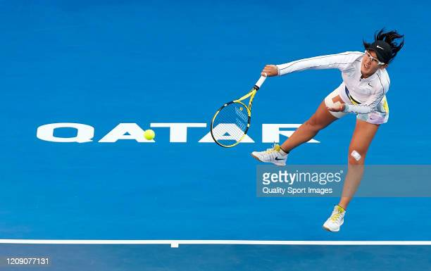 Saisai Zheng of China serves against Aryna Sabalenka of Belarus during day five of the WTA Qatar Total Open 2020 at Khalifa International Tennis and...