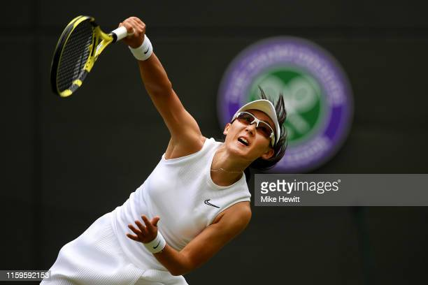 Saisai Zheng of China serves in her Ladies' Singles first round match against Ashleigh Barty of Australia during Day two of The Championships...