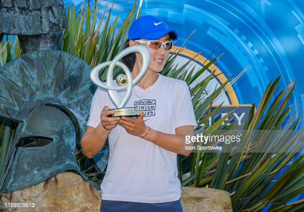 Saisai Zheng poses with her Championship trophy in front of the San Jose Spartans statue after the Singles Final match of the Mubadala Silicon Valley...