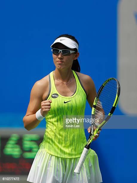 Saisai Zheng reacts in a match against Yaroslava Shvedova of Kazakhstan during Day 1 of the 2016 Wuhan Open at Optics Valley International Tennis...
