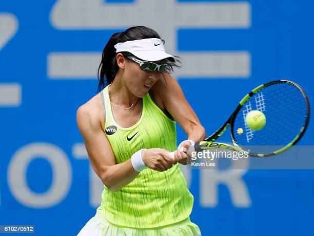 Saisai Zheng returns a shot to Yaroslava Shvedova of Kazakhstan in a match during Day 1 of the 2016 Wuhan Open at Optics Valley International Tennis...
