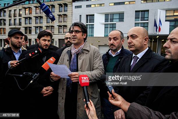 Sait Jurnal Yunus Celikoglu Bekier Yilmaz Sinan Kaplan and Uensal Tokuc give a press statement outside the French Embassy among candles messages and...