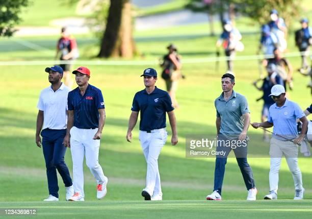 Saitama , Japan - 1 August 2021; Bronze Medal play-off players, from left, Juan Sebastián Muñoz of Colombia, Collin Morikawa of USA, Mito Pereira of...