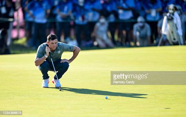 Saitama , Japan - 1 August 2021; Rory McIlroy of Ireland lines up a putt on the 18th green during the bronze medal playoff in round 4 of the men's...
