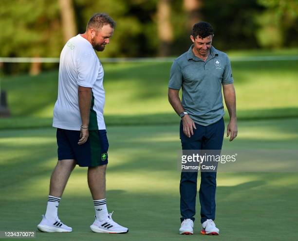 Saitama , Japan - 1 August 2021; Rory McIlroy of Ireland looks back on his missed putt on the 11th with Shane Lowry of Ireland during the bronze...