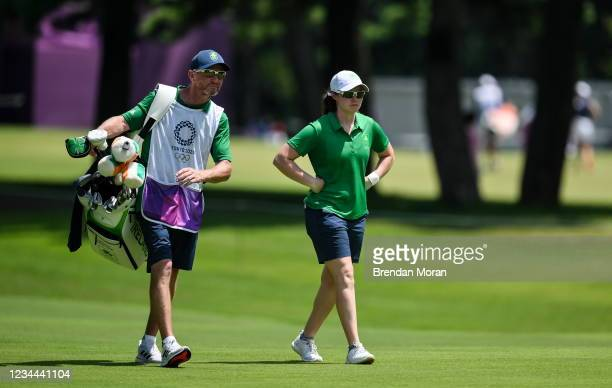 Saitama , Japan - 4 August 2021; Leona Maguire of Ireland and her caddie Diarmuid Byrne walk the 12th fairway during round one of the women's...