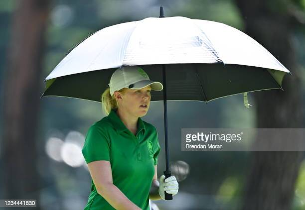 Saitama , Japan - 4 August 2021; Stephanie Meadow of Ireland uses an umbrella to shelter from the heat on the 14th fairway during round one of the...